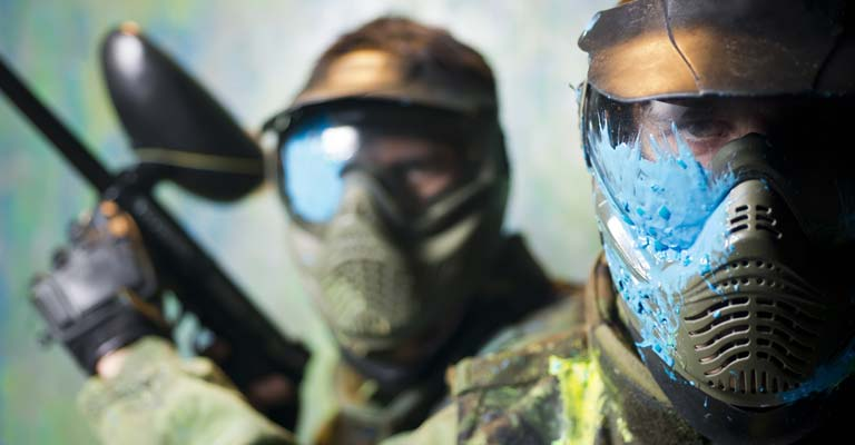 Paintball players in gear